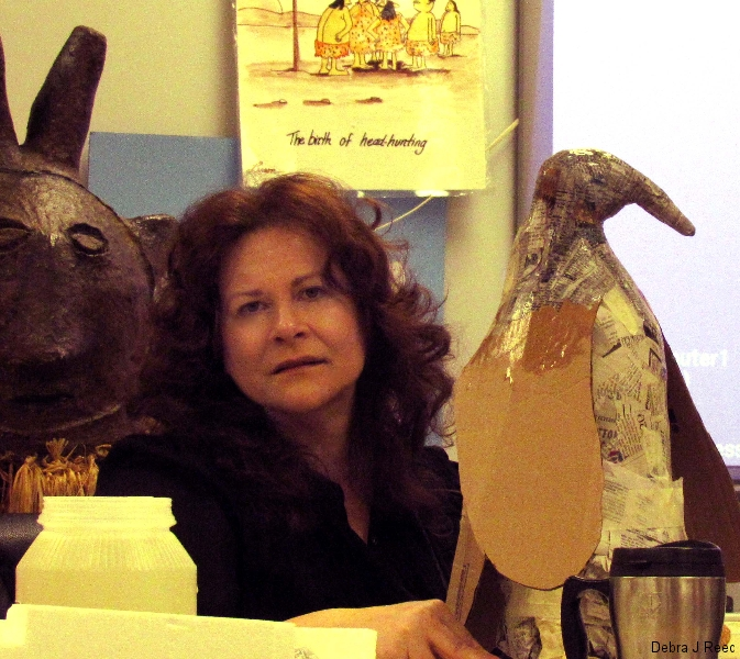 Debra-teaching-papier-mache-with-penguin